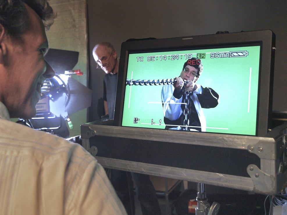 Director Glenn Holsten watches Buddy nail a scene.