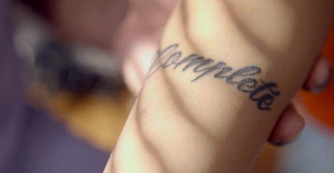 "Monica's recent tatoo says ""Complete"" - chosen family"